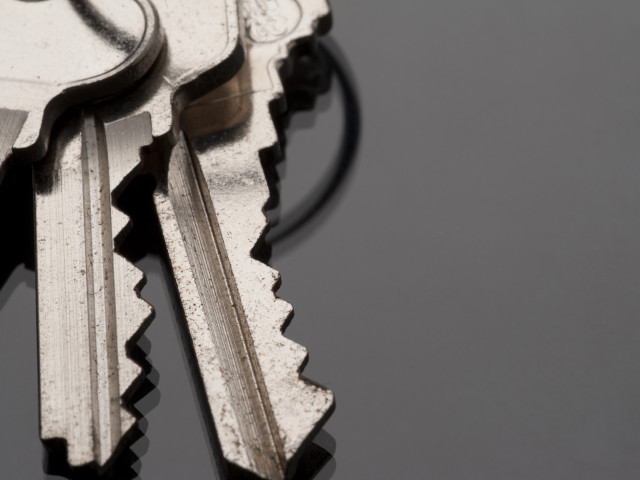 macro image of three keys on a keyring